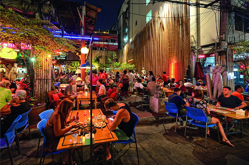 "Nightlife in Bangkok | Image Courtesy: By Mr.Peerapong Prasutr [<a href=""http://creativecommons.org/licenses/by-sa/4.0"">CC BY-SA 4.0</a>], <a href=""https://commons.wikimedia.org/wiki/File%3ABangkok_Khaosan2.jpg"">via Wikimedia Commons</a>"