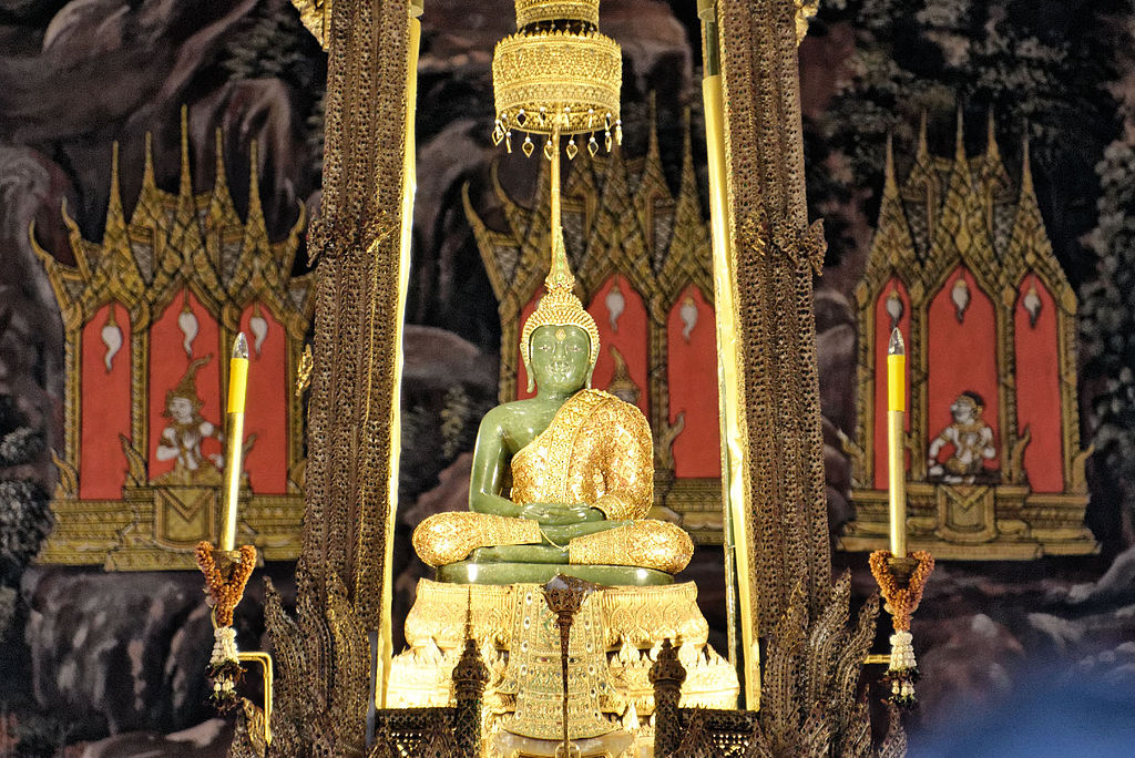 "Emerald Buddha | Image Credit: <a href=""https://commons.wikimedia.org/wiki/User:JPSwimmer"">JPSwimmer</a>, <a href=""https://commons.wikimedia.org/wiki/File:Emerald_Buddha,_August_2012,_Bangkok.jpg"">Emerald Buddha, August 2012, Bangkok</a>, <a href=""https://creativecommons.org/licenses/by-sa/3.0/legalcode"" rel=""license"">CC BY-SA 3.0</a>"