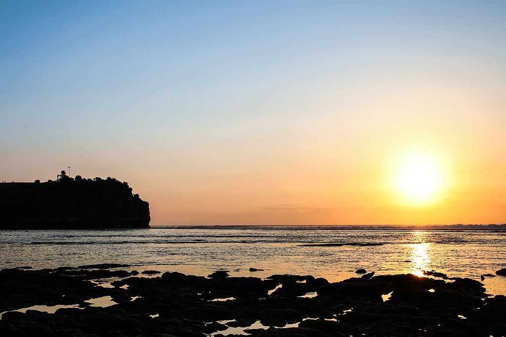 "Balangan Beach | Image Credit: <a href=""https://commons.wikimedia.org/wiki/User:Wokshots"">Wokshots</a>, <a href=""https://commons.wikimedia.org/wiki/File:Balangan_sunset_blue_and_orange_bali_travel_photos_wokshots.jpg"">Balangan sunset blue and orange bali travel photos wokshots</a>, <a href=""https://creativecommons.org/licenses/by-sa/4.0/legalcode"" rel=""license"">CC BY-SA 4.0</a>"