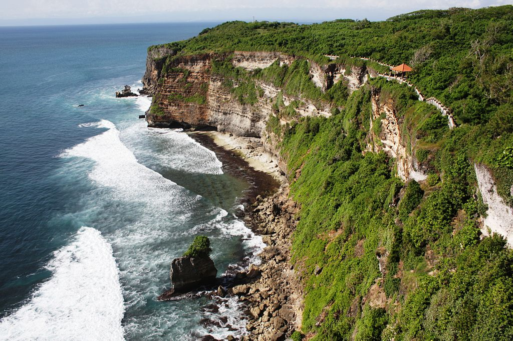 "Uluwatu  | Image Credit: <a href=""https://en.wikipedia.org/wiki/id:User:Sanko"">Sanko</a> at <a href=""https://en.wikipedia.org/wiki/id:"">Indonesian Wikipedia</a>, <a href=""https://commons.wikimedia.org/wiki/File:PuraLuhurUluWatu_view.jpg"">PuraLuhurUluWatu view</a>, <a href=""https://creativecommons.org/licenses/by-sa/3.0/legalcode"" rel=""license"">CC BY-SA 3.0</a>"